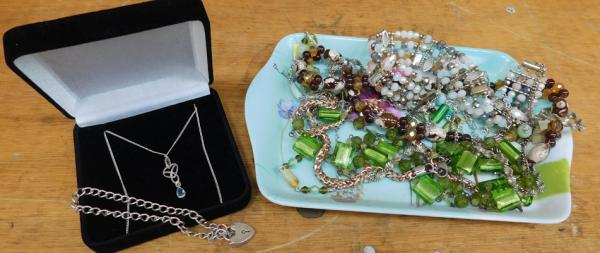 Assortment of costume jewellery and silver charm bracelet and necklace