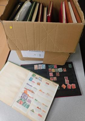 Box containing 11x stamp albums