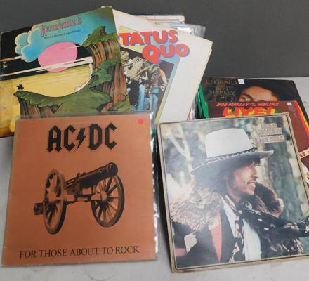 Box of albums including Hawkwind, AC/DC, Dylan and Marley