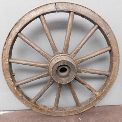 "1 large antique cartwheel ( approx 36"" diameter) some damage to one spoke"