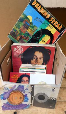 Over 60 Reggae records - LPs & 7 inch singles, well used, some rare