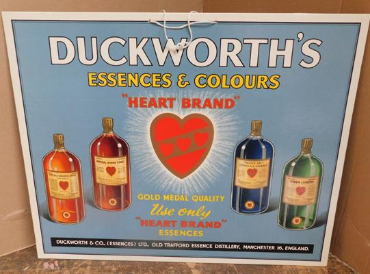 Original 1930s cardboard sign for Duckworths Essences