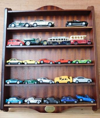 Treen collectors rack of vintage diecast cars x20