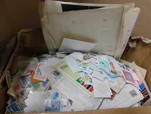 Box containing 10,000++ World stamps