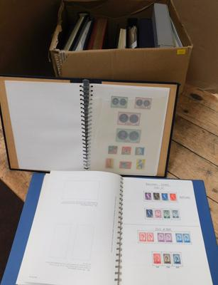 Box containing 12 albums of World stamps