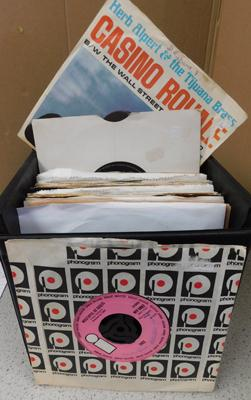 Box of singles in case inc Traffic, Free (approx 55 singles)