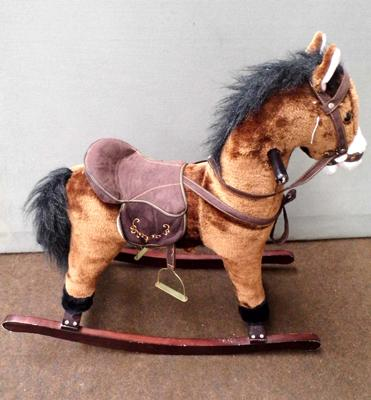 Childs brown rocking horse