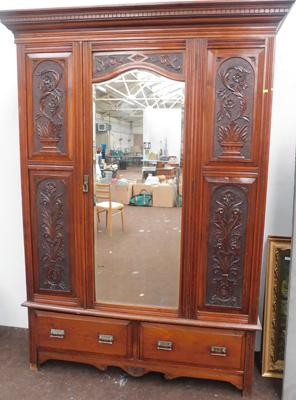 Large oak carved design wardrobe with mirrored front, approx. 54 x 83 inches