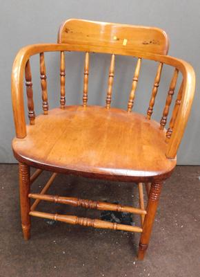 Spindle backed captains style chair