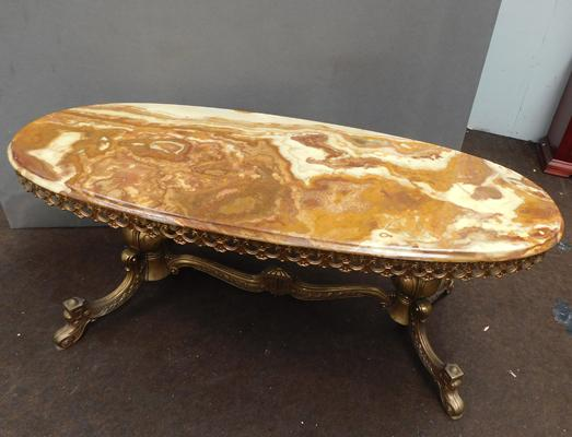 Onyx coffee table with brass base, approx. 48 x 20 inches