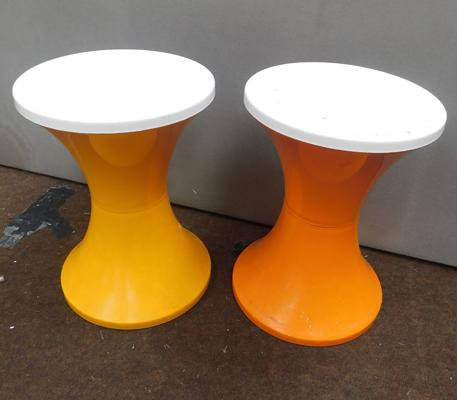 Two orange retro plastic stools, approx. 17 inches tall
