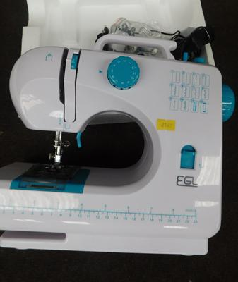 Compact EGL sewing machine, boxed