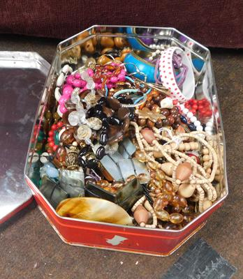 Tin of costume jewellery