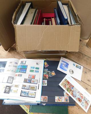Heavy carton containing 16 stamp albums etc