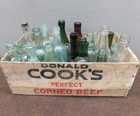 Vintage wooden crate of bottles