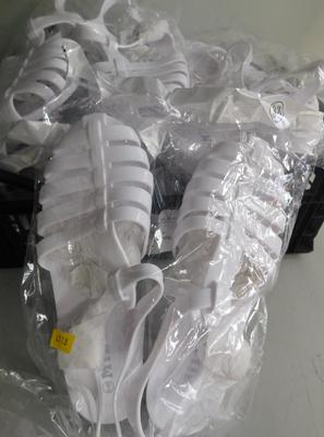 10 Pairs of white plastic sandals-various sizes