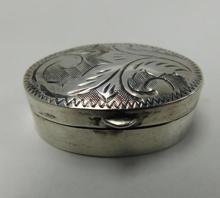Silver pill box with patterned top