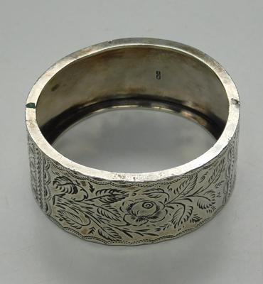 Victorian silver childs bangle with flower design, hallmarked 1883