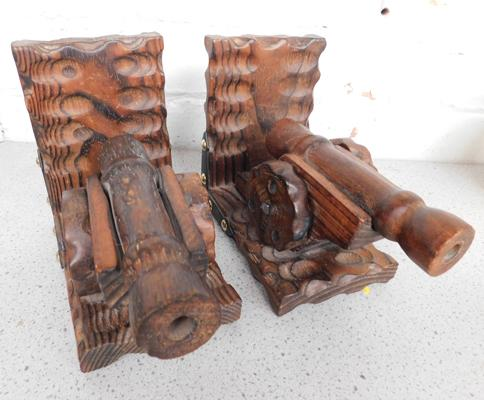 Pair of carved wooden cannon book ends