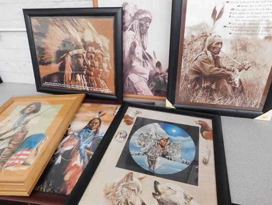 Large assortment of red/American Indian framed prints