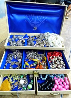 Large assortment of costume jewellery in case