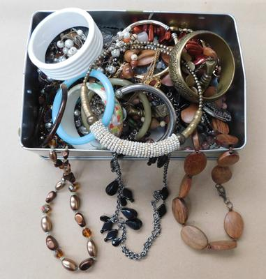 Tin full of vintage costume jewellery inc bangles, necklaces, watches