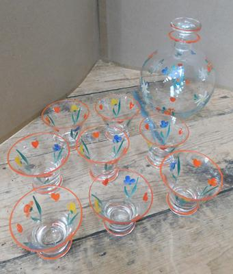 Hand-painted decanter & 8 glasses, some damage to rims