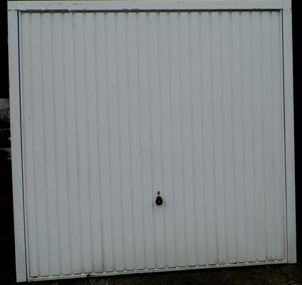 Metal up and over garage door, approx. 90 x 87 inch frame - with key