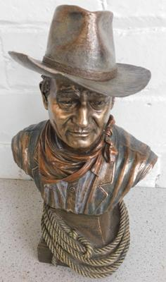 Bronzed John Wayne figure, chips to hat, approx. 10.5 inches tall