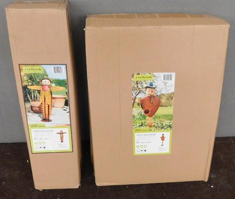 Two different new garden scarecrows (boxed)