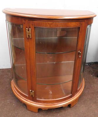 Oak display cabinet with arched frontage & glass shelves