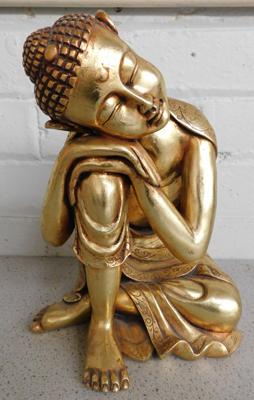 Resting Buddha painted in 18ct gold leaf from film set of Victoria, filmed at Wentworth Woodhouse, approx. 11 inches high