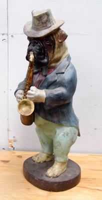 Resin pug dog with saxophone
