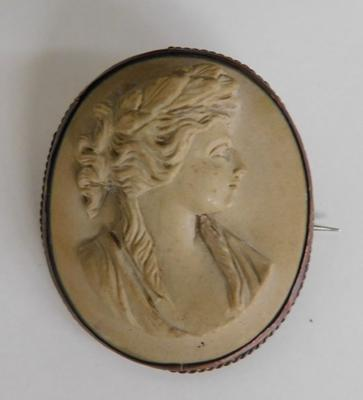 Antique Victorian lava cameo brooch with yellow metal mount