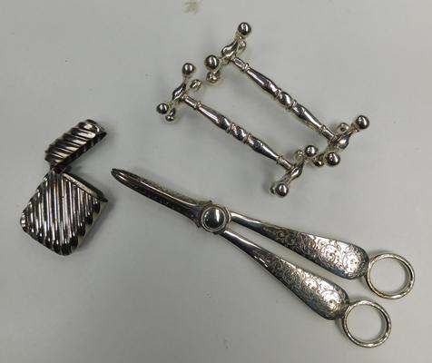3 white metal grape scissors, a beacon vesta and a pair of knife rests