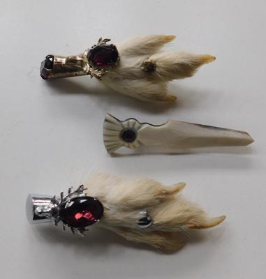3 x vintage kilt brooches, two silver coloured & amethyst jeweled rabbits feet & one Bakelite brooch