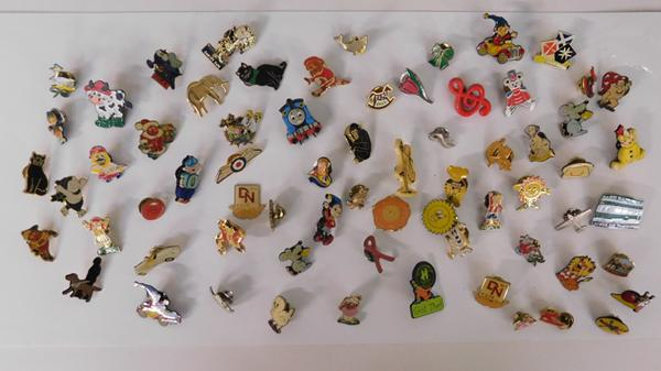 Large collection of metal pin badges