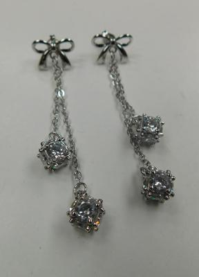 Silver bow and drop earrings