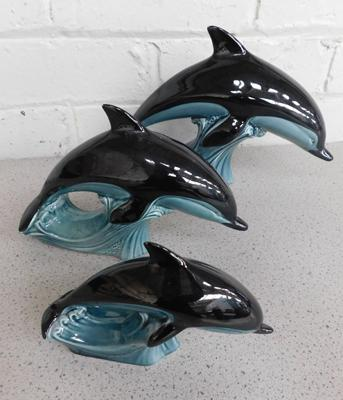Three graduating Poole Pottery dolphins, slight nibble on fin otherwise no damage