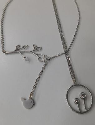 "2 unusual silver (925) pendants on 16"" silver chains"