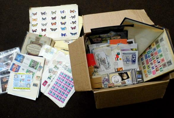 Box of stamps, albums and quantity of old cigarette cards in albums