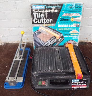 Electric tile cutter in working order and one other