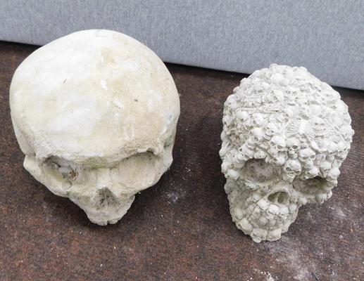 "Concrete pair of skulls size 4.5"" high"