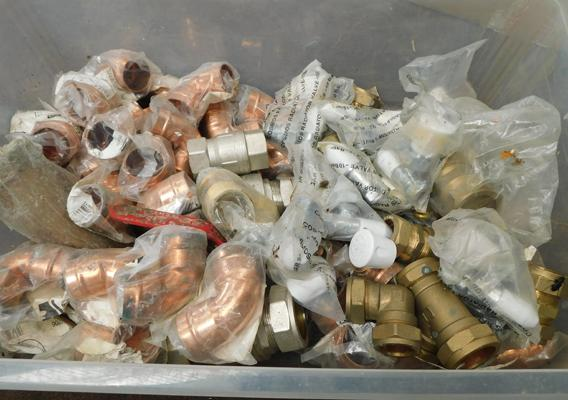 Box of plumbers brass and copper fittings