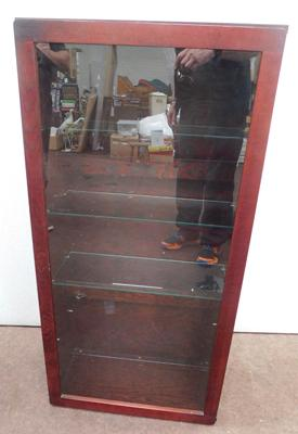 Glass fronted wall mountable display cabinet - one glass shelf missing