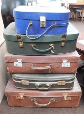 Selection of five vintage suitcases