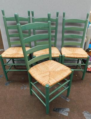 Four dining chairs with wicker seats