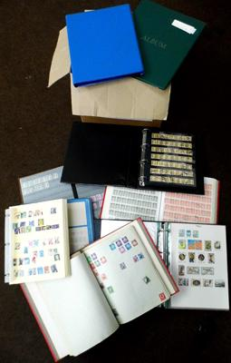 Box containing world stamps in 8 large binders/albums