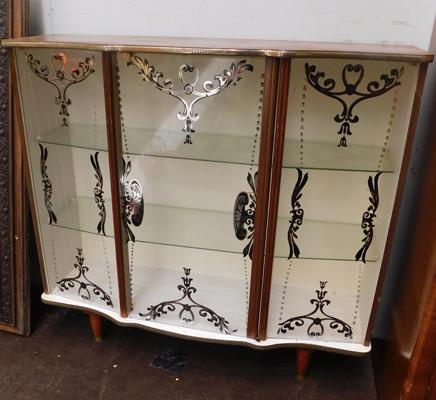Ornate glass fronted china display cabinet with motifs