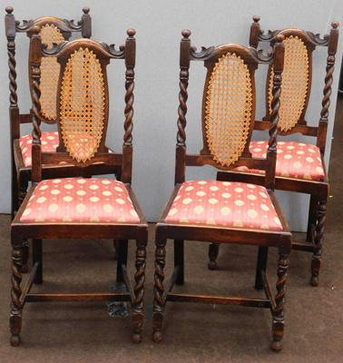 Four rattan backed oak dining chairs